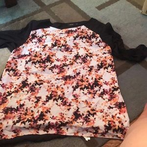 Black and floral blouse with back cut out
